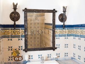 Фасады (фасадные системы) из натурального камня Kings'Stone. - Художественная ковка в интерьере. Кованые светильники-факелы и обрамление зеркала.