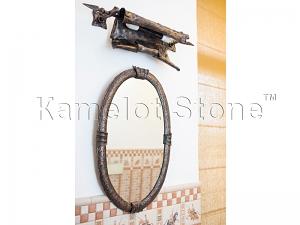 Фасады (фасадные системы) из натурального камня Kings'Stone. - Художественная ковка в интерьере. Зеркало в кованой раме, над ним настенный светильник имитирующий свиток бумаги.