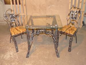 Фасады (фасадные системы) из натурального камня Kings'Stone. - Художественная ковка. Стол и стулья с растительными элементами ковки.